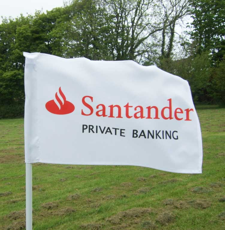 santander golf flag displayed in a field for presentation purposes